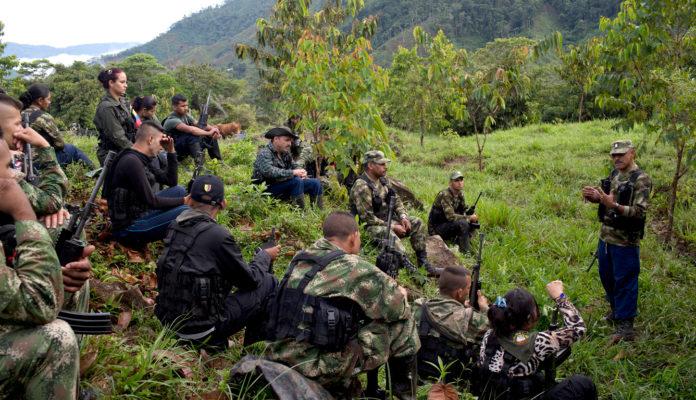18-01-16-Leonidas-commander-36th-front-FARC-EX-farc-mafia-dissidents-Credit-Rodrigo-Abd-AP_123461069100-696x400